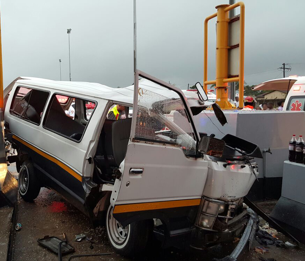 Taxi crashes into toll plaza1